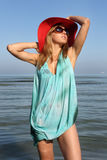 Woman in red hat and sunglasses posing Royalty Free Stock Image