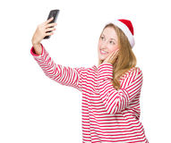 Woman with red hat and take selfie Royalty Free Stock Image