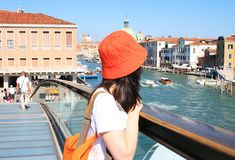 Woman in red hat in Venice Stock Images