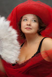 Woman in red hat with white fan Stock Photos