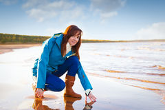 Woman in red have fun on cost of the lake Stock Photography