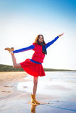 Woman in red have fun on the cost of lake Stock Photography