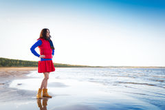 Woman in red have fun on the cost of lake Royalty Free Stock Images