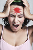 Woman with red headache mark Royalty Free Stock Photography