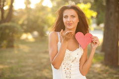 Woman with red heart Stock Images