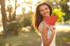Woman with red heart Royalty Free Stock Photo