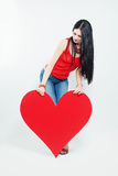 Woman and Red Heart Stock Image