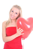 Woman with red heart balloon Stock Images