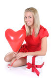 Woman with red heart balloon Stock Photo