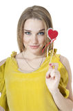 Woman with red heart. Royalty Free Stock Images