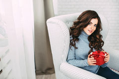 Woman with red heart present. Stock Photography