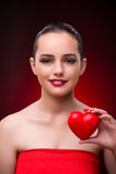 The woman with red heart in romantic concept Stock Photography
