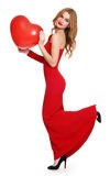 Woman in red with heart shape balloon Royalty Free Stock Image