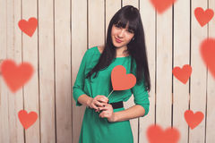 Woman with red heart Royalty Free Stock Photography