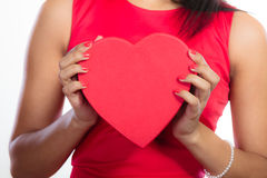 Woman with red heart shaped gift box Royalty Free Stock Images