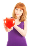 Woman with red heart-shaped  jewel box (focus on face) Stock Photography
