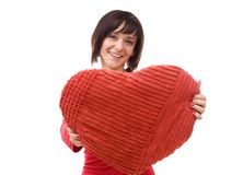 Woman with red heart-shaped pillow Royalty Free Stock Images