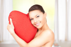 Woman with red heart-shaped pillow Royalty Free Stock Photo