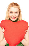 Woman with red heart-shaped pillow Royalty Free Stock Photos