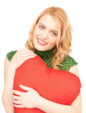 Woman with red heart-shaped pillow Stock Image