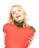 Woman with red heart-shaped pillow Stock Images