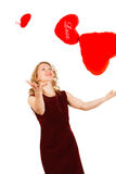 Woman with a red heart on a white background Stock Image