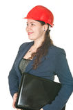 Woman in red helmet with laptop Stock Photo