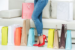 Woman in red high-heeled shoes Stock Photography