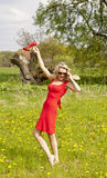 Woman with red high heels in a meadow Royalty Free Stock Images