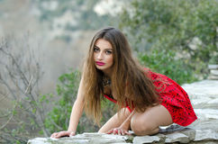 Woman in red high heels and red short dress Royalty Free Stock Image