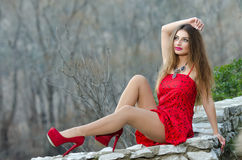Woman in red high heels and red short dress Royalty Free Stock Photos
