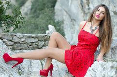 Woman in red high heels and red short dress Stock Photography
