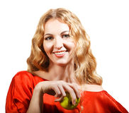 Woman in red holding apple in her hand Stock Photography