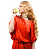 Woman in red holding apple in her hand Royalty Free Stock Image