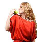 Woman in red holding apple in her hand Royalty Free Stock Images