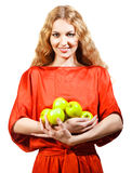 Woman in red holding apples in her hands Stock Images
