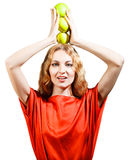 Woman in red holding apples in her hands Stock Photography