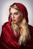 Woman with Red Hood and Cape Royalty Free Stock Photography