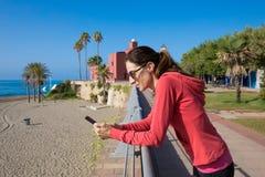 Woman using phone in promenade of Benalmadena royalty free stock images