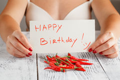 Woman with red hot chilli on table. And message Royalty Free Stock Images