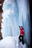 Woman in red and icefall Royalty Free Stock Photography