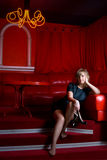 Woman in red interior Stock Image