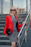 Woman in red jacket standing on the shop Royalty Free Stock Image