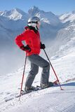Woman in Red Jacket Wearing Helmet and Holding Snow Ski Stick Stock Photography