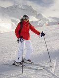 Woman in Red Jacket and White Pants on White Snow Royalty Free Stock Images