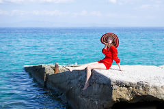 Woman in red jumpsuit and hat Royalty Free Stock Photography