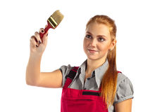 Woman in red jumpsuit with paint brush royalty free stock image