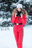 Woman in a red jumpsuit in the winter Stock Photo