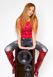 Woman with red knee-high boots on loudspeaker Royalty Free Stock Image
