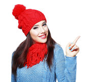Woman in red knit scarf and hat Stock Images